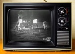 Picture of moon landing on old black and white TV. Has YouTube logo in bottom right corner of TV picture.